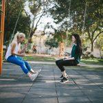 women talking on swing